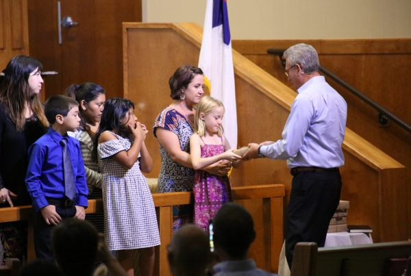 Children receiving their Bibles in worship